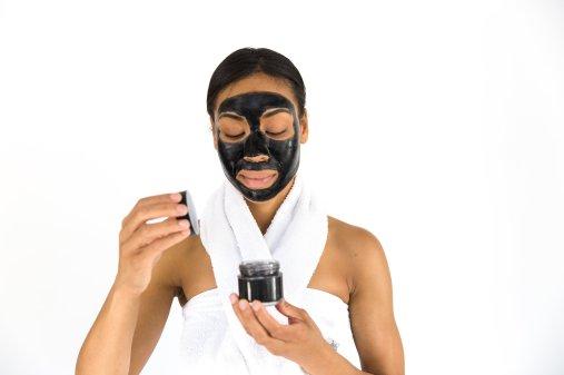 woman-opening-cosmetic-jar_4460x4460.jpg